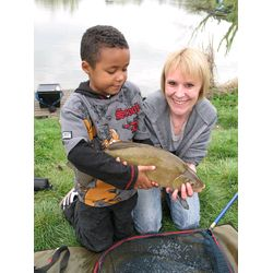 Karen bags a lovely 6lb Tench and we are all smiles!